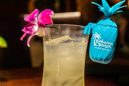 Kennesaw, GA - July 12th 2019: Tropical island beach themed drinks at Bahama Breeze with shot of rum or tequila. Fun, fruity drinks at American chain, part of Darden Restaurants. Sajtókép