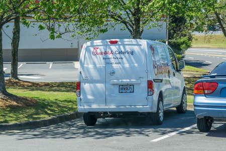 Kennesaw, GA / USA - 04/02/20: White Chick-fil-a caterting van parked in Kennesaw, GA on Barrett Parkway.