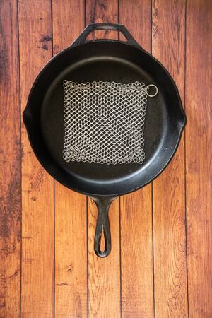 Small Ring Chainmail Scrubber - for Cast Iron, Stainless Steel, Hard Anodized Cookware and Other Pots & Pans. For for Cast Iron Cookware, Dutch Ovens, Casseroles, Stainless Steel Cookware, Woks and more. Stock Photo