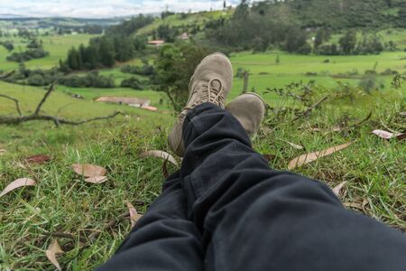 Man resting on the grass of a farm