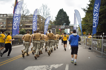 Bogota Colombia. (May 06, 2018). A group of National Navy soldiers trotting is reaching the goal. 新聞圖片