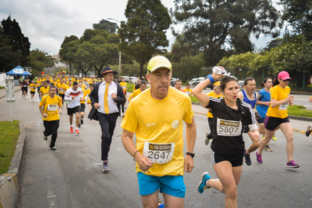 Bogota, Colombia. (May 06, 2018). Even with a suit of cloth, tie and hat the Bogotanos left to run the 10k for the Heroes