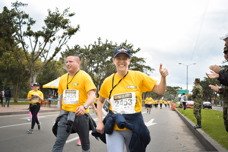 Bogota Colombia. (May 06, 2018). A couple of runners greet us smiling and with a thumbs up while they run in the Race for the Heroes in Bogota.