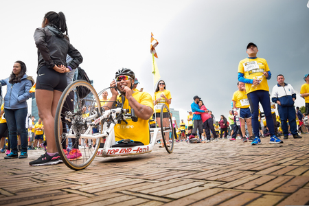 Bogota Colombia. (May 06, 2018). A HandCycle athlete, at the end of the race, he happily calls his family by phone Foto de archivo - 121982070