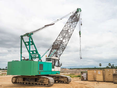 Green truck crane in outdoor photo