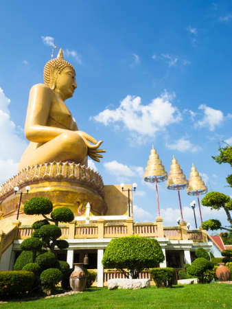 Big buddha statue with blue sky background photo