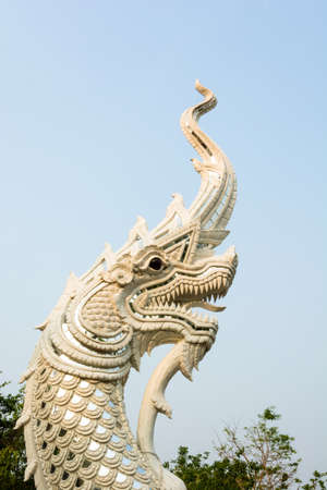 White naga statue in blue sky, open a mouth to elegance  photo