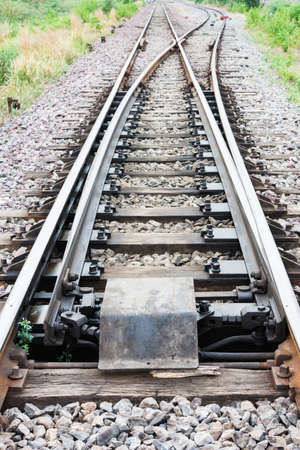 Main railway track separated to two railway tracks, main railway track on gravel going to two railway tracks on forward  Stock Photo