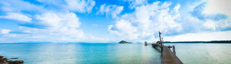 trad: Pier wood on sea in panorama view, tranquil of blue sea and sky for relextion in holiday, KohMak - Trat ,Thailand
