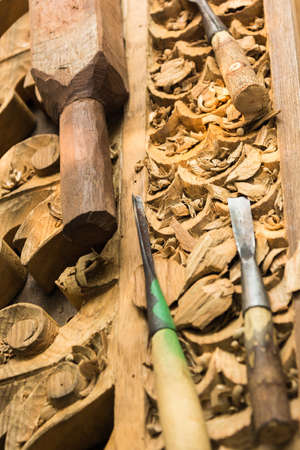 timbering: Tools and wood to be carved