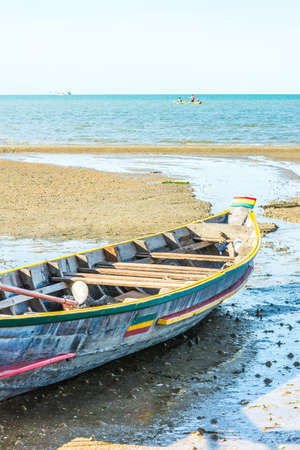 Beach with fishing boats on the sea photo