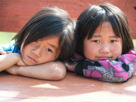 PETCHABOON,THAILAND -JANUARY 2010 : Children were playing happily in a kindergarten school in mountain area at Petchaboon province.
