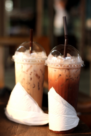 Thai style iced coffee cup wrapped with napkin Stock Photo