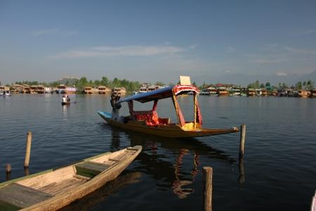 kashmir: SRINAGAR, INDIA - April 20: Lifestyle in Dal lake,local people use Shikara, a small boat for transportation in the lake., April 20, 2012 in Srinagar, Kashmir, India
