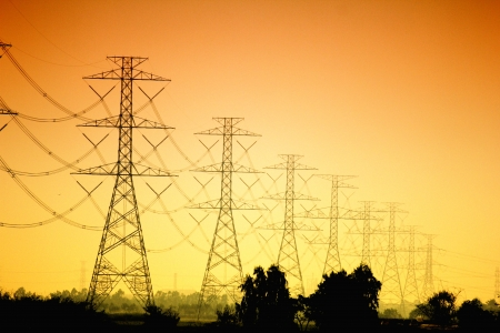 insulators: Electricity pylons and lines at sunset near Bangkok, Thailand Stock Photo