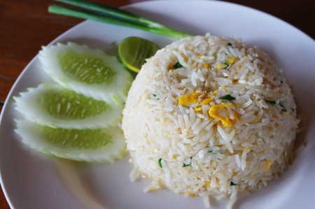 close-up fried rice with eggs , served with cucumber photo