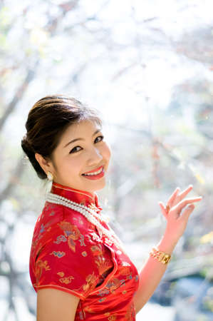 beautiful asian girl in red chinese traditional dress  qipao  photo