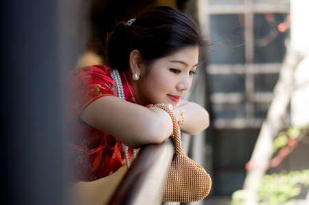 qipao: beautiful asian girl in red chinese traditional dress  qipao