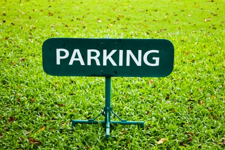 parking sign over green lawn photo