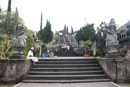 pilgrim costume: BALI - OCTOBER 17: Unidentified tourists visiting Besakih temple in October 17, 2012 in Bali, Indonesia.