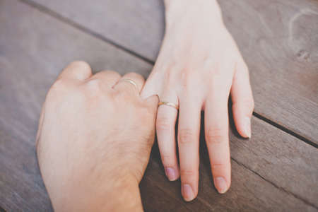 top view of couple hands with wedding  rings Stock Photo - 18542356