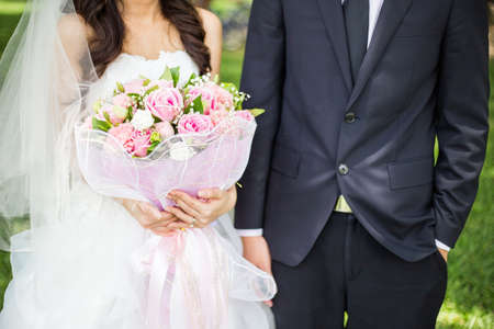 groom and bride holding bouquet