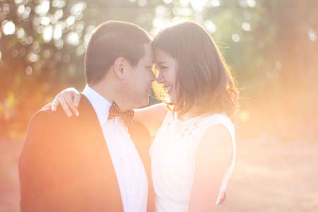 man and woman looking into each other eyes  with love and warm atmosphere photo