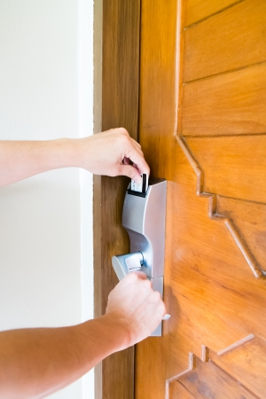 inserting: hand inserting hotel keycard Stock Photo