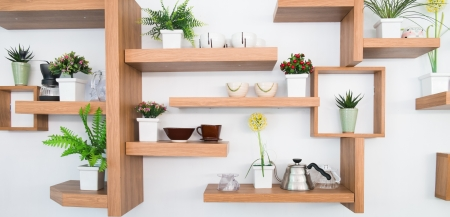 wooden shelf on wall and ceramics photo