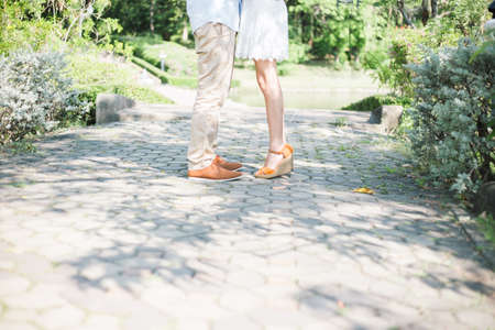 fashionable couple standing in a park,vintage style Stock Photo