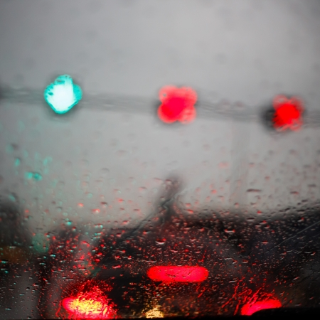 view through the windshield of a car during rain photo