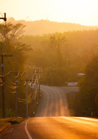 morning sunbeams in rural road Stock Photo