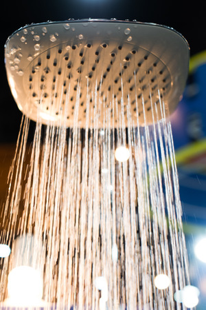 shower stall: shower head water drops with sparkles and streams of water with light