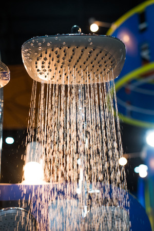 shower head water drops with sparkles and streams of water with light Stock Photo - 27042614