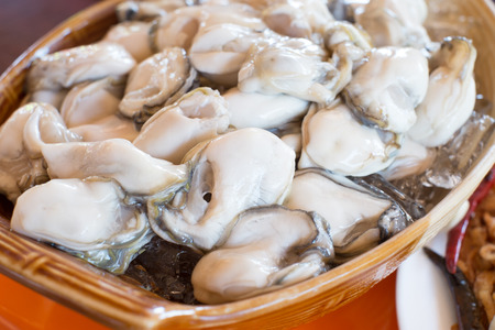 raw oyster served with spice side dishes in Thailand Stock Photo