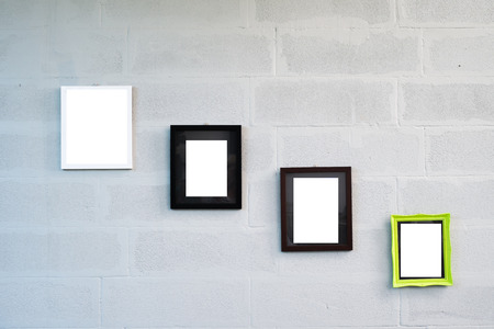 empty photo frames on white concrete wall photo