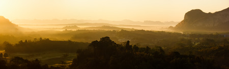 panorama of morning sunrise mountain landscape in southern of thailand photo