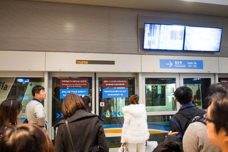 incheon: INCHEON, SOUTH KOREA - DECEMBER 8: Unidentified passengers travelling inside Incheon Airport on December 8, 2014 in Incheon, South Korea.