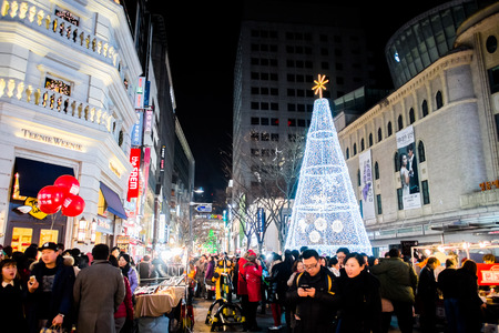 SEOUL, SOUTH KOREA -DECEMBER 7, 2014: Unidentified people at Myeong-Dong district at night. Myeongdong is one of Seoul�s main shopping districts, famous for hi-end fashion outlet, cosmatics and street food.