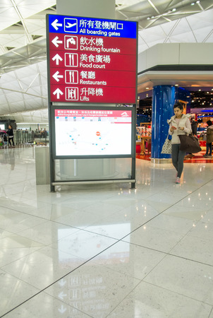 colloquially: HONG KONG, CHINA - JANUARY 11: Interior of Hongkong airport on January 11, 2015 in Hong Kong, China. The airport is also colloquially known as Chek Lap Kok Airport.