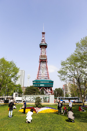 odori: SAPPORO, JAPAN - MAY 6, 2015: Recreation of Japaneses and tourists during Japan Golden week at Sapporo TV Tower located on the ground of Odori Park.