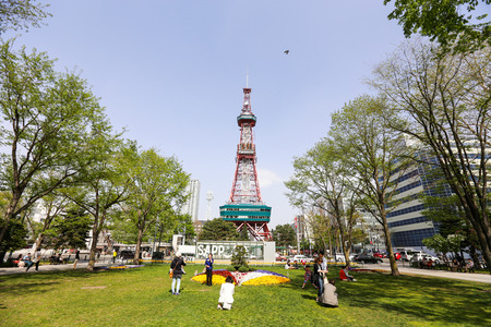 sapporo: SAPPORO, JAPAN - MAY 6, 2015: Recreation of Japaneses and tourists during Japan Golden week at Sapporo TV Tower located on the ground of Odori Park.