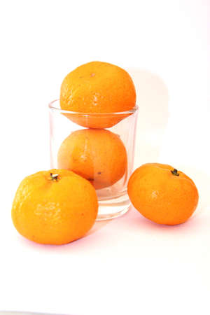 Mandarin orange with glass Stock Photo