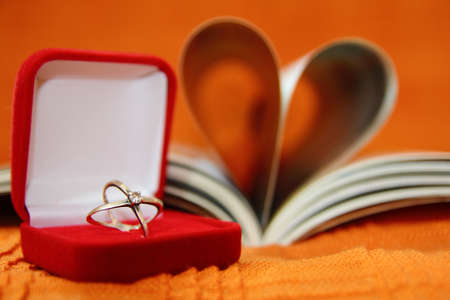 Wedding ring and heart book Stock Photo