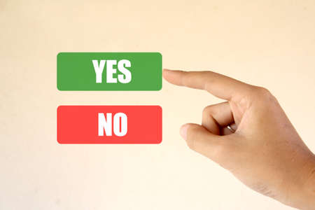 Hand and buttons YesNo (Choose Yes) photo