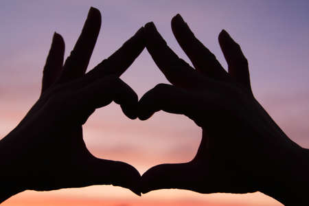 Hands Silhouette with Love Heart