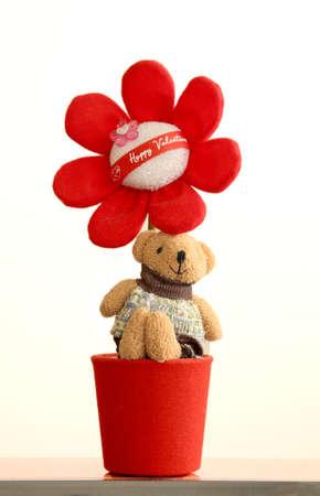Teddy bear on red flowerpot Stock Photo