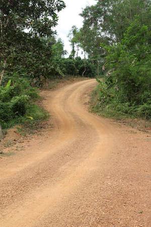 Rural road between green fields Stock Photo - 12880727