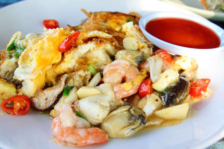 Seafood Thai omelette with chilli sauce