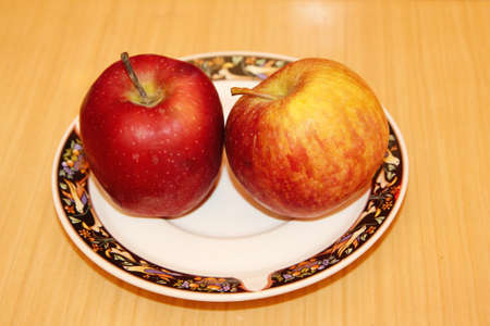 Red little apple on plate